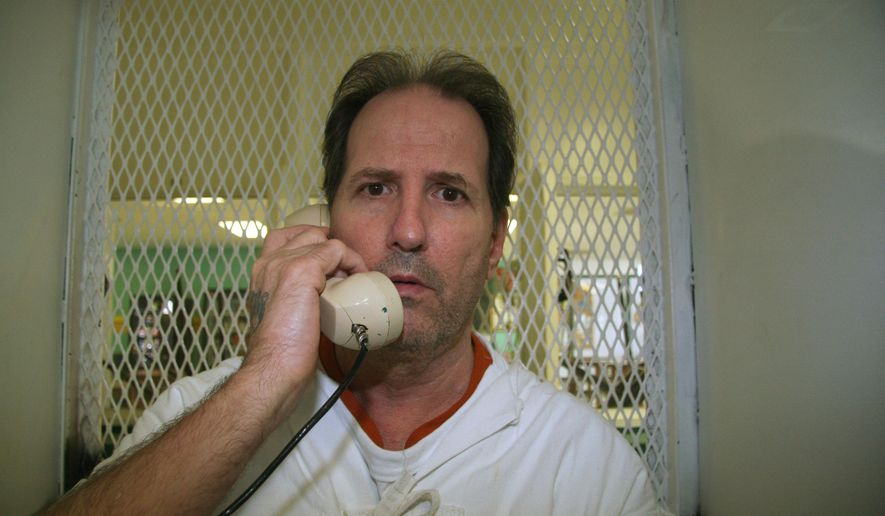 Condemned inmate Max Soffar, 58, speaks from a visiting cage at death row at the Texas Department of Criminal Justice Polunsky Unit near Livingston, Texas on Wednesday, Aug, 13, 2014. Soffar, one of Texas' longest-serving death row inmates, has liver cancer and has been told he has only a few months to live. His attorneys are asking the state parole board to grant him clemency and freedom. Soffar was convicted of a robbery shooting in Houston in 1980 where three people were killed and a fourth seriously hurt.  He has been tried, convicted and condemned twice but insists he is innocent. (AP Photo/Michael Graczyk)