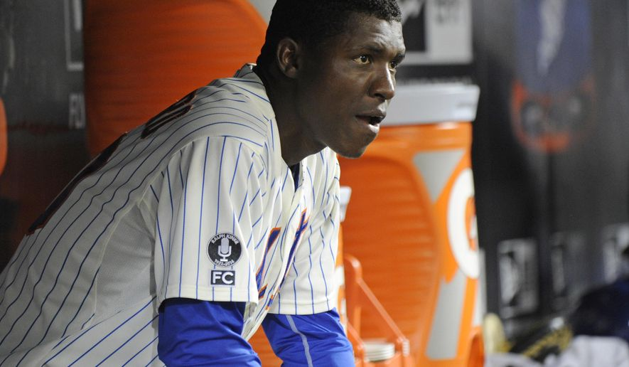 New York Mets pitcher Rafael Montero looks on from the dugout after leaving the baseball game during the sixth inning against the Washington Nationals  Tuesday, Aug.12, 2014, at Citi Field in New York. the Nationals won 7-1. (AP Photo/Bill Kostroun)