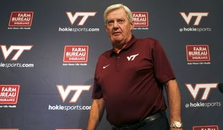 Virginia Tech football head coach Frank Beamer arrives for a preseason news conference in Blacksburg Va. Saturday Aug.  9 2014. Virginia Tech football players and staff held their annual media and fan appreciation day in Lane Stadium. (AP Photo/The Roanoke Times, Matt Gentry)