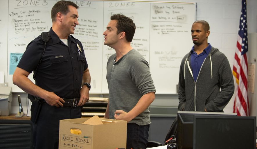 "This image released by 20th Century Fox shows Rob Riggle, from left, Jake Johnson, and Damon Wayans, Jr. in a scene from, ""Let's Be Cops."" (AP Photo/20th Century Fox, Frank Masi)"