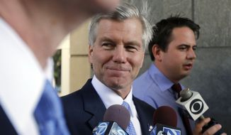 Former Gov. Robert McDonnell, center, leaves the federal courthouse in Richmond, Va. on Wednesday, Aug. 13, 2014 on day 13 of the corruption trial of McDonnell and former first lady Maureen McDonnell. (AP Photo/The Richmond Times-Dispatch, Joe Mahoney)