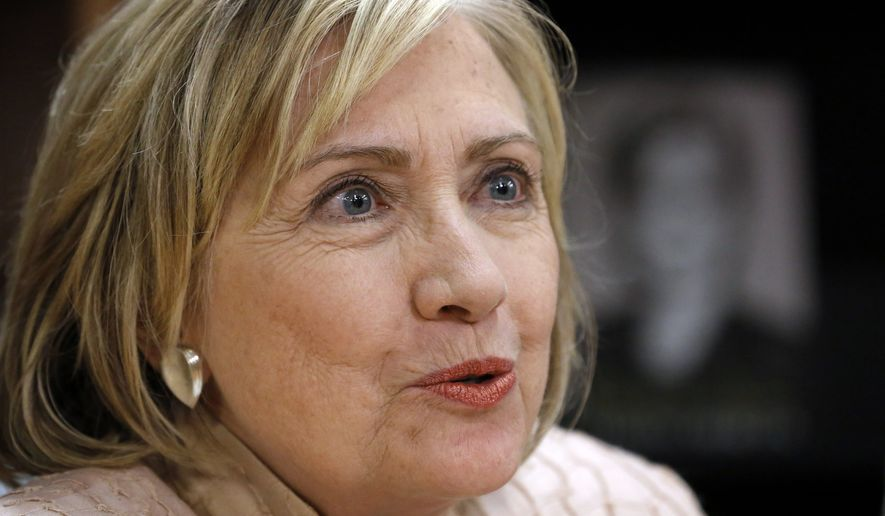 """** FILE ** Former Secretary of State Hillary Rodham Clinton speaks at a signing for her book """"Hard Choices"""" while in Vineyard Haven, Mass., Aug. 13, 2014. (AP Photo/Steven Senne)"""