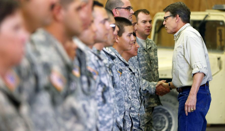 Gov. Rick Perry shakes hands with National Guard troops training at Camp Swift in Bastrop, Texas on Wednesday, Aug. 13, 2014. Perry visited some of the 1,000 troops he has ordered to the Texas-Mexico border but says he does not know how long they'll be deployed. (AP Photo/San Antonio Express-News, William Luther)