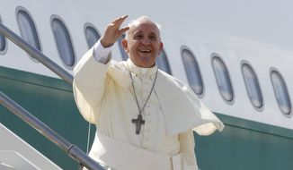 On Wednesday, Pope Francis waves as he boards a plane on his way to South Korea for a five-day visit. The visit marks the first time in a quarter-century that a pope has been on the divided Korean peninsula. Francis plans to bring a message of peace and reconciliations to Koreans on both sides of the 38th parallel, while encouraging Catholics in the region to spread their faith.  (AP Photo/Riccardo De Luca)