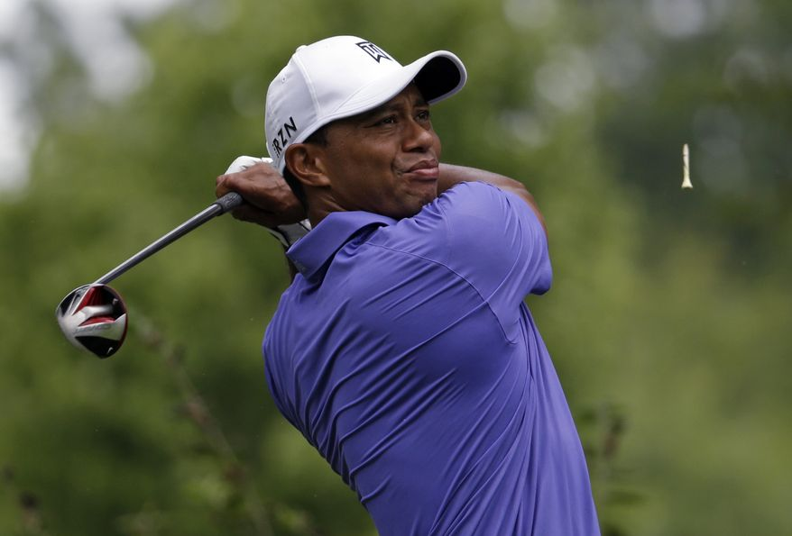 Tiger Woods watches his tee shot on the ninth hole during the first round of the PGA Championship golf tournament at Valhalla Golf Club on Thursday, Aug. 7, 2014, in Louisville, Ky. (AP Photo/John Locher)