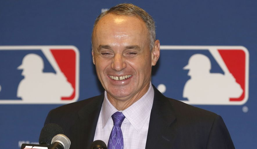 FILE - In this Nov. 14, 2013, file photo, Major League Baseball Chief Operating Officer Rob Manfred talks to the media following baseball's general managers' meetings in Orlando, Fla. Baseball's 30 owners will meet in Baltimore this week to vote on Major League Baseball Commissioner Bud Selig's replacement. A seven-man committee whittled down an expansive list to three candidates: MLB Chief Operating Officer Rob Manfred, Boston Red Sox Chairman Tom Werner and MLB Executive Vice President of Business Tim Brosnan. (AP Photo/Reinhold Matay, File)