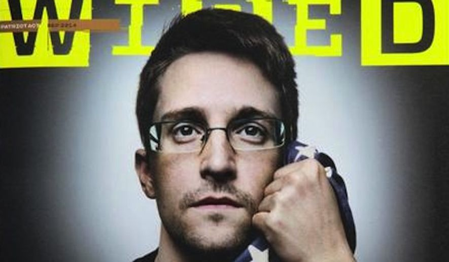 National Security Agency leaker Edward Snowden appears in the September issue of WIRED magazine wrapping himself in the American flag. (Twitter/Platon)