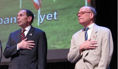 "Veterans Affairs Secretary Robert McDonald, left, and U.S. Rep. Steve Cohen listen to the ""Star-Spangled Banner"" before McDonald's speech at the American Veterans national convention on Wednesday, Aug. 13, 2014, in Memphis, Tenn. (AP Photo/Adrian Sainz)."