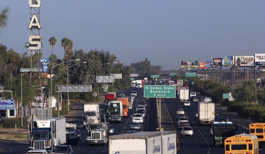 File - This Oct. 5, 2012 file photo shows truckers and cars shown driving along California State Route 99 in Fresno, Calif. A new state of California survey ranks Fresno and other communities in the Central Valley as the hardest-hit by pollution, joblessness and other problems. (AP Photo/Gary Kazanjian, file)