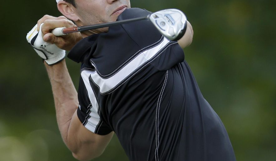 Camilo Villegas, of Colombia, watches his tee shot on the eighth hole during the first round of the Wyndham Championship golf tournament in Greensboro, N.C., Thursday, Aug. 14, 2014. (AP Photo/Chuck Burton)
