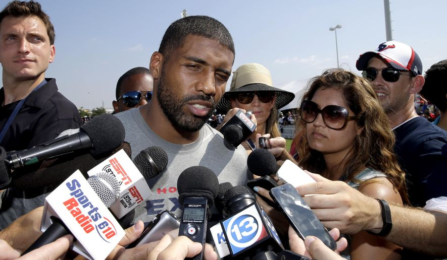 Houston Texans running back Arian Foster answers questions from reporters after an NFL football training camp practice Thursday, Aug. 14, 2014, in Houston. (AP Photo/David J. Phillip)