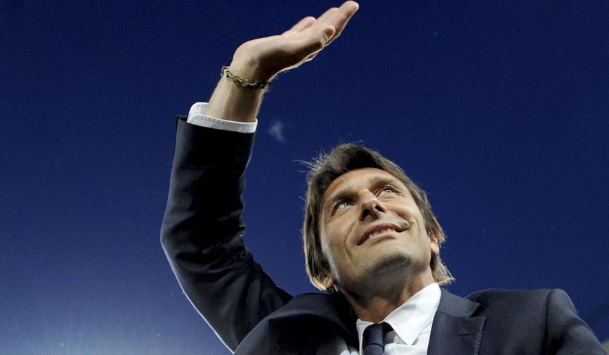 FILE - In this May 5, 2014 file photo, Juventus coach Antonio Conte waves to supporters prior to the start of a Serie A soccer match between Juventus and Atalanta at the Juventus stadium, in Turin, Italy. Former Juventus manager Antonio Conte is the new coach of Italy, after signing a two-year contract. The Italian football federation announced the news on Thursday, Aug. 14, 2014 three days after new president Carlo Tavecchio was elected. The 45-year-old Conte replaces Cesare Prandelli, who resigned, along with former FIGC president Giancarlo Abete, immediately after Italy's early elimination from the World Cup in Brazil. (AP Photo/Massimo Pinca, File)