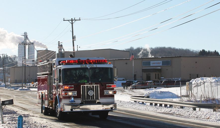 In this photo from Jan 31, 2014, a firetruck rolls past Mersen USA where an explosion killed one person and injured two in St. Marys, Pa. Federal safety officials said a worker wrongly put parts coated with flammable materials into an electric oven before it exploded at the plant, killing a visiting employee. (AP Photo/ Dubois Courier Express-JoAnn Seltzer)