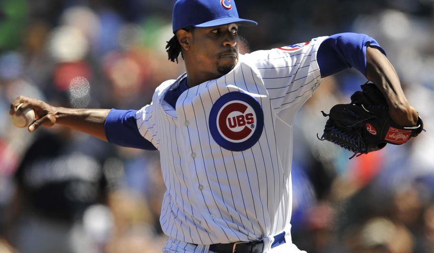 Chicago Cubs starter Edwin Jackson delivers a pitch during the first inning of a baseball game against the Milwaukee Brewers in Chicago, Aug. 14, 2014. (AP Photo/Paul Beaty)