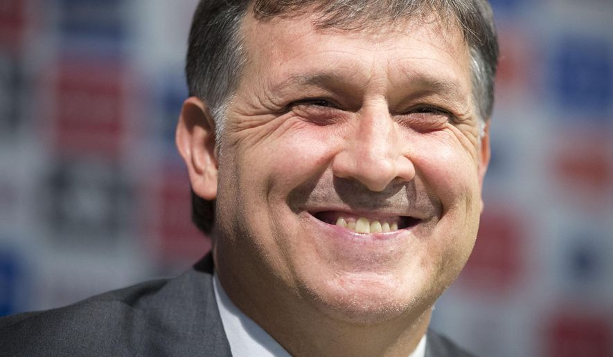 Gerardo Martino, newly-named head coach for the Argentina national soccer team, smiles during a news conference in Buenos Aires, Argentina, Thursday, Aug. 14, 2014. (AP Photo/Victor R. Caivano)