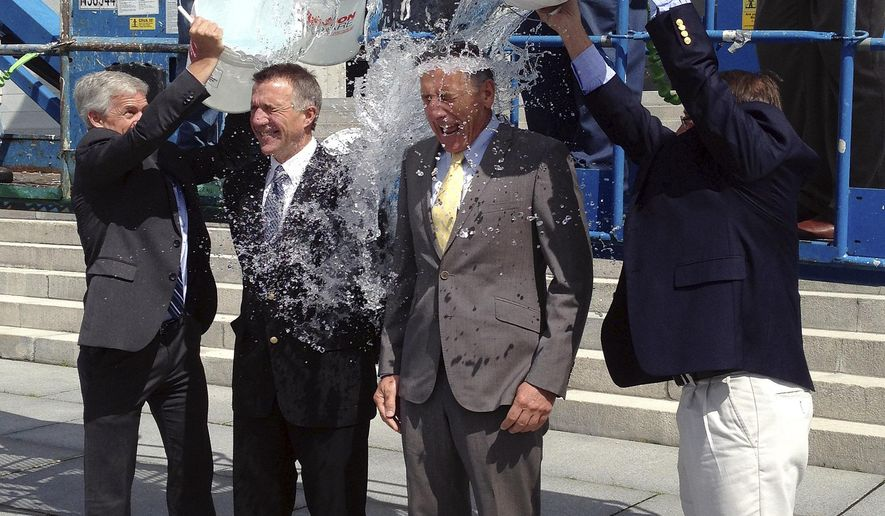 """Vermont Lt. Gov. Phil Scott, second from left, and Gov. Peter Shumlin, second from right, take the """"ice bucket challenge"""" at the Vermont Statehouse Thursday, Aug. 14, 2014, in Montpelier, Vt. They were doused by Montpelier Mayor John Hollar, left, Barre Mayor Thom Lauzon, right, and a team of dousers working from a crane above. The challenge is aimed at raising funds to fight ALS, also known as Lou Gehrig's disease. (AP Photo/Dave Gram)"""