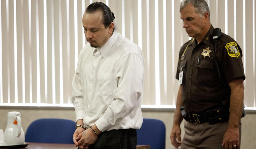 In this photo taken on Wednesday, Aug. 13, 2014, Manuel Gamez is led out of the courtroom by St. Clair County Sheriff deputies in the St. Clair County Circuit Court in Port Huron, Mich. The Times Herald of Port Huron reports that jurors on Wednesday found the 32-year-old Gamez guilty of two counts of first-degree murder, two counts of torture and one count of first-degree criminal sexual conduct in the deaths of a Michigan couple. Sentencing is scheduled Sept. 17. Gamez faces a mandatory term of life in prison without parole. (AP Photo/The Port Huron Times Herald, Jeffrey Smith)  NO SALES