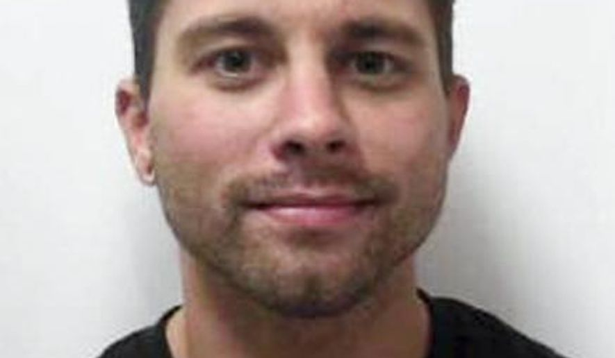 This photo provided by the Tri-County Jail in Mechanicsburg, Ohio, shows Zachary Butler. Butler has been arrested on murder charges after the assault and subsequent death of inmate David Piersol, on April 5, 2014. (AP Photo/Tri-County Jail)