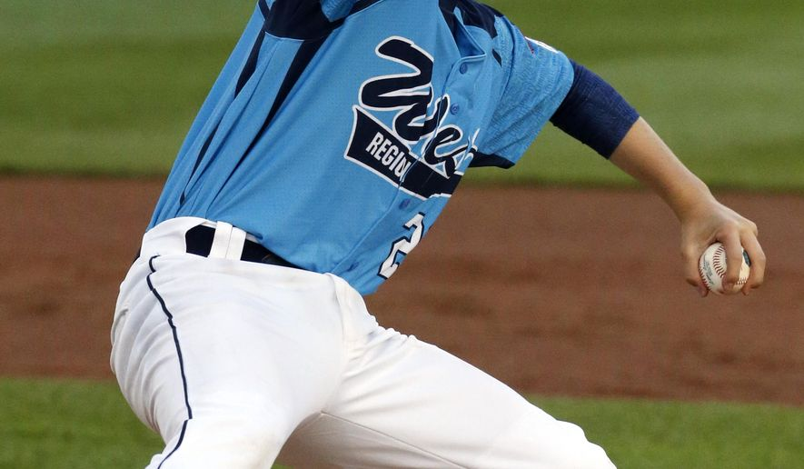 Las Vegas pitcher Austin Kryszczuk delivers during the second inning of a baseball game against Rapid City, South Dakota in United States pool play at the Little League World Series tournament in South Williamsport, Pa., Thursday, Aug. 14, 2014. (AP Photo/Gene J. Puskar)