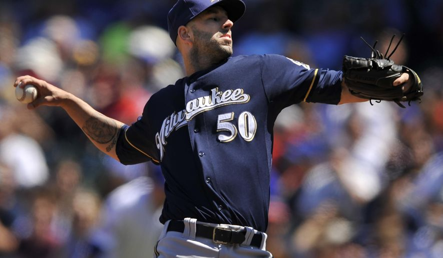 Milwaukee Brewers starter Mike Fiers delivers a pitch during the first inning of a baseball game against the Chicago Cubs in Chicago, Aug. 14, 2014. (AP Photo/Paul Beaty)