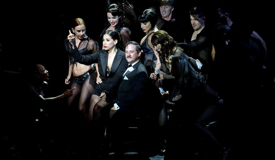 "This image released by The Publicity Office shows Christopher Fitzgerald, center, as slick lawyer Billy Flynn during a performance of the musical ""Chicago."" The actor, who made his debut in the show last October as Roxie Hart's put-upon husband Amos Hart, has just stepped into the role of slick lawyer Billy Flynn, becoming the first actor in the show's 18-year history to be contracted to perform both starring male roles. (AP Photo/The Publicity Office)"