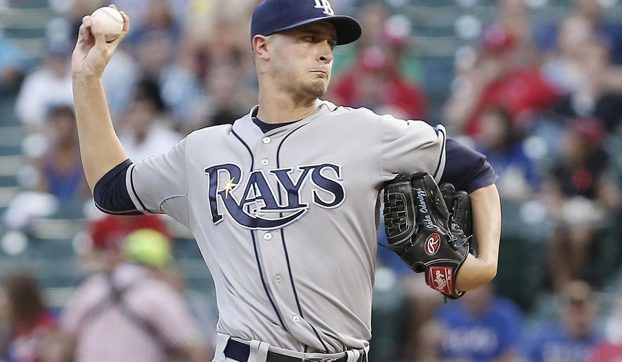 Tampa Bay Rays starting pitcher Jake Odorizzi (23) throws during the first inning of a baseball game against the Texas Rangers, Thursday, Aug. 14, 2014, in Arlington, Texas. (AP Photo/Brandon Wade)