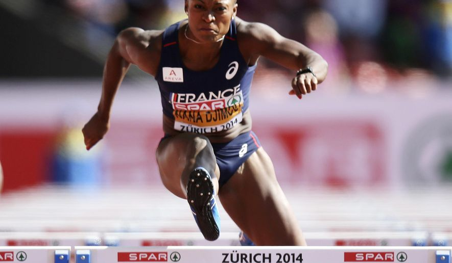 France's Antoinette Nana Djimou clears a hurdle in the 100m hurdles heat of the heptathlon during the European Athletics Championships in Zurich, Switzerland, Thursday, Aug. 14, 2014. (AP Photo/Petr David Josek)