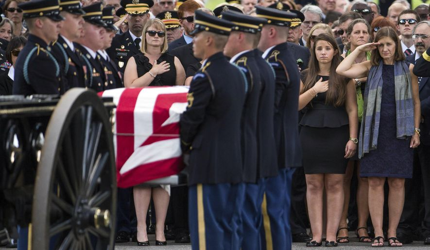 Retired Col. Susan Myers, right, stands with her daughter Amelia Greene and salutes as the casket of her husband, Army Maj. Gen. Harold Greene, is carried by an honor guard during a burial service at Arlington National Cemetery, on Thursday, Aug. 14, 2014, in Arlington, Va. Greene was killed when a gunman dressed as an Afghan soldier turned on ISAF troops, wounding about 15 including a German general and two Afghan generals. He is the highest-ranking U.S. military officer to be killed in America's post-9/11 wars. (AP Photo/Evan Vucci)