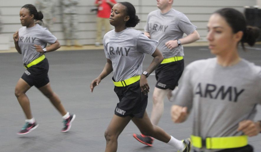 "ADVANCE FOR SUNDAY, AUG. 17 - Spc. Montega Freeman, center, 62nd Engineer Battalion, 36th Engineer Brigade, runs during a ""beep testing"" while participating in a physical fitness testing, July 16, 2014, at Fort Hood, Texas. (AP Photo/Killeen Daily Herald, Catrina Rawson)"