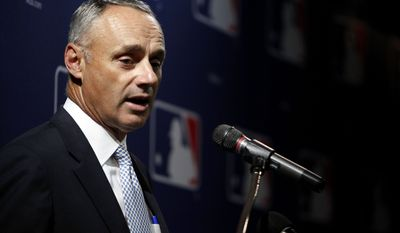 **FILE** Rob Manfred, Chief Operating Officer of Major League Baseball talks during a press conference to announce a joint initiative with the Major League Baseball Players Association that will positively impact the development of youth baseball in San Juan, Puerto Rico, Thursday, June 19, 2014. (AP Photo/Ricardo Arduengo)