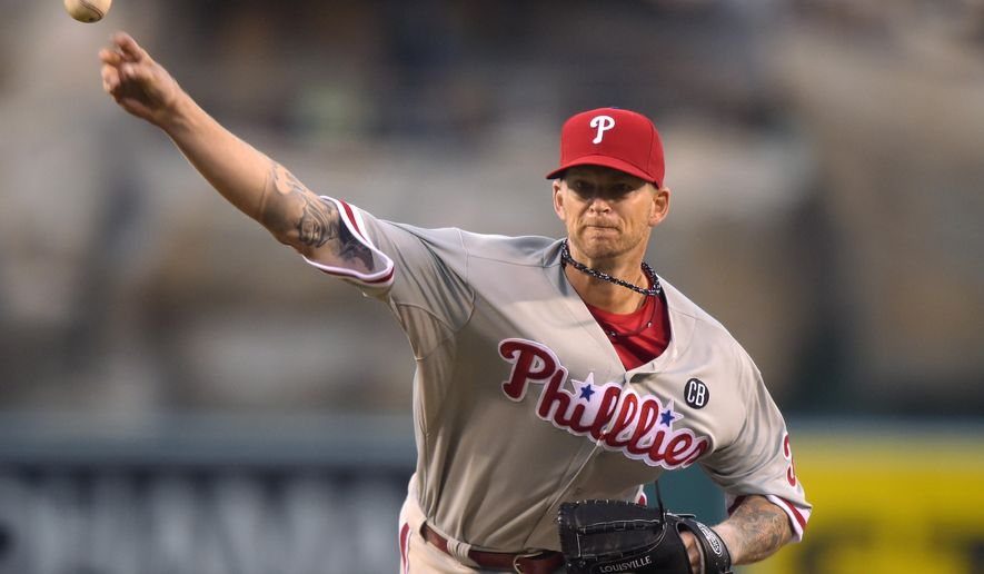 Philadelphia Phillies starting pitcher A.J. Burnett throws to the plate during the first inning of a baseball game, Wednesday, Aug. 13, 2014, in Anaheim, Calif. (AP Photo/Mark J. Terrill)
