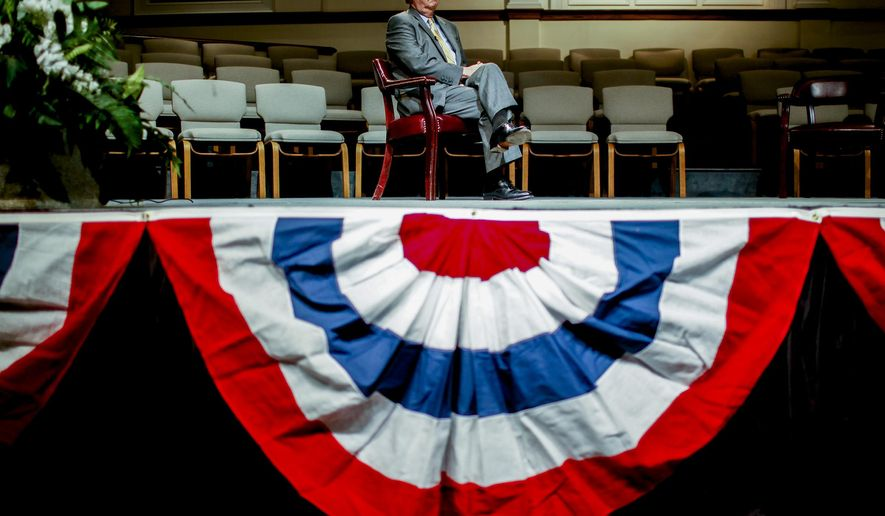 Sen. Mitch McConnell, R-Ky., answers questions from a panel at Eastwood Baptist Church in Bowling Green, Ky. on Thursday, Aug. 14, 2014. (AP Photo/Daily News, Austin Anthony)