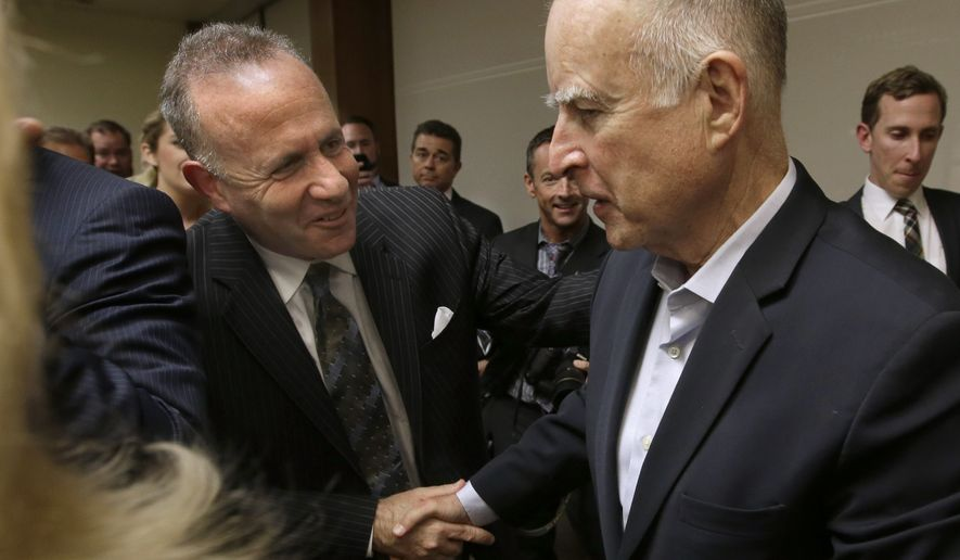 Gov. Jerry Brown, right, shakes hands with Senate President Pro Tem Darrell Steinberg, D-Sacramento, after Brown signed to measure t0 place a $7.5 billion water plan on the November ballot, Wednesday, Aug. 13, 2014, in Sacramento, Calif.  The measure replaces an existing water bond that was approved by a previous Legislature but was widely considered to costly and unlikely to be approved by voters. The water plan was approved by lawmakers earlier in the day after weeks of negotiations between Brown and legislative leaders.(AP Photo/Rich Pedroncelli)