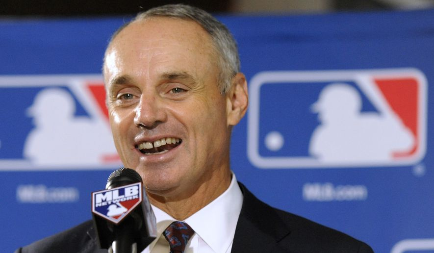 Major League Baseball Chief Operating Officer Rob Manfred speaks to reporters after team owners elected him as the next commissioner of Major League Baseball during an owners quarterly meeting in Baltimore, Thursday, Aug. 14, 2014. (AP Photo/Steve Ruark)