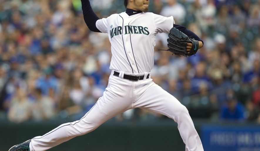 Seattle Mariners starter Hisashi Iwakuma delivers a pitch during first inning of a baseball game against the Toronto Blue Jays, Wednesday, Aug. 13, 2014, in Seattle. (AP Photo/Stephen Brashear)