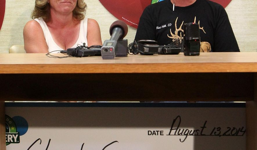 "Claude ""Al"" G. and his wife, Jackie, of Rifle, Colo., smile as they answer questions during a news conference about their $90 million Powerball jackpot, Wednesday, Aug. 13, 2014, in Grand Junction, Colo.  (AP Photo/The Grand Junction Daily Sentinel, Gretel Daugherty)"