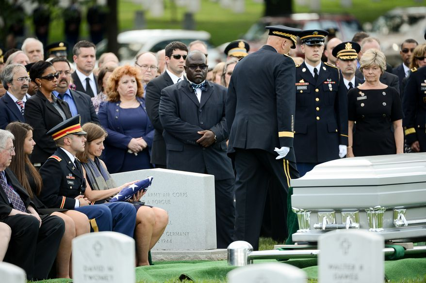 The family of Army Maj. Gen. Harold J. Greene, from left, father Harold Greene, daughter Amelia Greene, son Army 1st Lt. Matthew Greene and his wife, Dr. Susan Myers, during his funeral service at Section 60 at Arlington National Cemetery, Arlington, Va., Thursday, August 14, 2014. Greene was killed in Afghanistan while at the national military academy in Kabul. He was the highest-ranking U.S. Army officer killed in combat since the Vietnam War. (Andrew Harnik/The Washington Times)