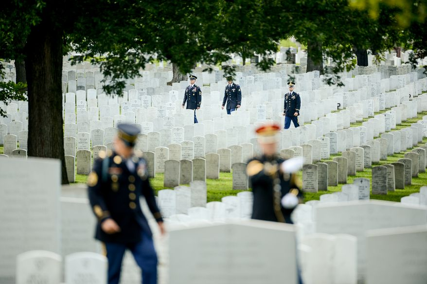 Members of the Old Guard get ready for the service for U.S. Army Maj. Gen. Harold J. Greene in Section 60 at Arlington National Cemetery, Arlington, Va., Thursday, August 14, 2014. Greene was killed in Afghanistan while at the national military academy in Kabul. He was the highest-ranking U.S. Army officer killed in combat since the Vietnam War. (Andrew Harnik/The Washington Times)