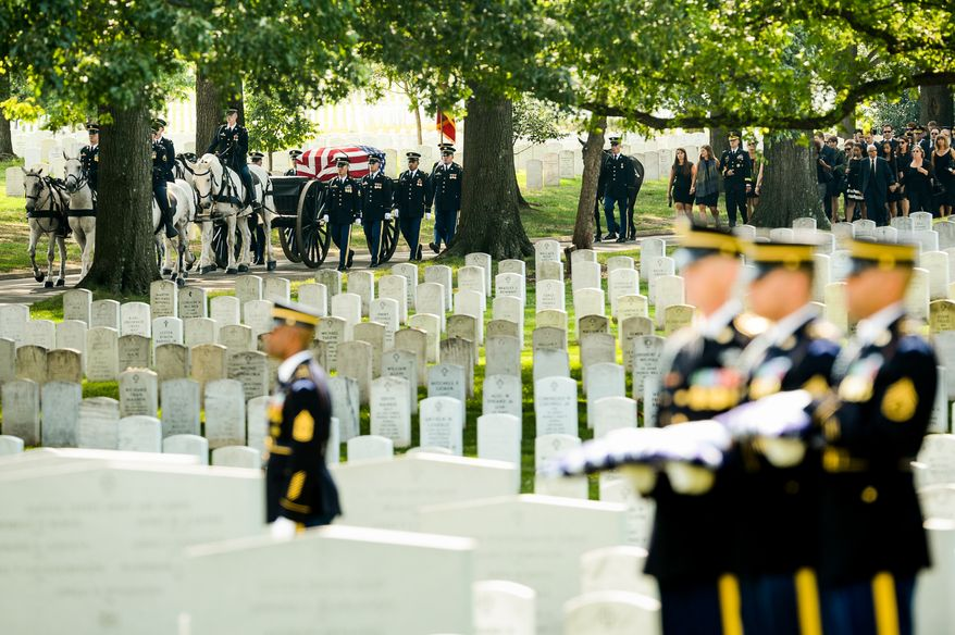 Members of the Old Guard brings the casket of U.S. Army Maj. Gen. Harold J. Greene by caisson to Section 60 at Arlington National Cemetery for his funeral service, Arlington, Va., Thursday, August 14, 2014. Greene was killed in Afghanistan while at the national military academy in Kabul. He was the highest-ranking U.S. Army officer killed in combat since the Vietnam War. (Andrew Harnik/The Washington Times)