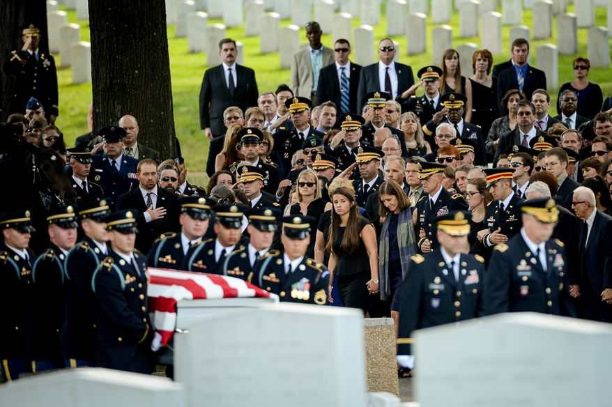 Family members, center, watch as members of the Old Guard carry the casket of U.S. Army Maj. Gen. Harold J. Greene into Section 60 for his funeral service at Arlington National Cemetery, Arlington, Va., Thursday, August 14, 2014. Greene was killed in Afghanistan while at the national military academy in Kabul. He was the highest-ranking U.S. Army officer killed in combat since the Vietnam War. (Andrew Harnik/The Washington Times)