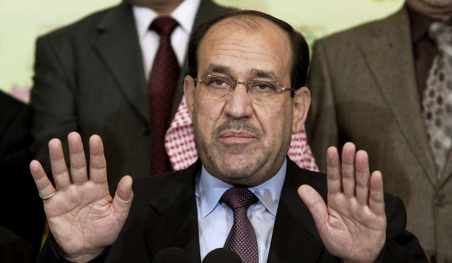 FILE - In this Friday, March 26, 2010 file photo, Iraqi Prime Minister Nouri al-Maliki speaks to the press in Baghdad, Iraq. Iraq's Nouri al-Maliki has given up his post as prime minister to Haider al-Abadi, state television reported Thursday, Aug. 14, 2014 — a move that could end a political deadlock that plunged Baghdad into uncertainty as the country fights a Sunni militant insurgency. (AP Photo/Hadi Mizban, File)
