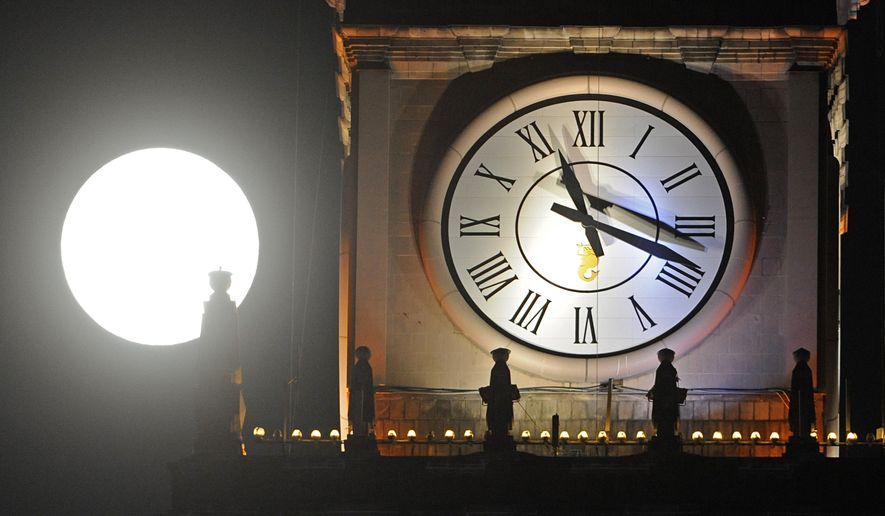 """The """"biological clock"""" is a well-known metaphor that refers to women's age-limited time for childbearing. But can just hearing a gentle """"tick tock"""" while thinking about marriage and babies make a difference in people's plans? (AP Photo, Alik Keplicz)"""