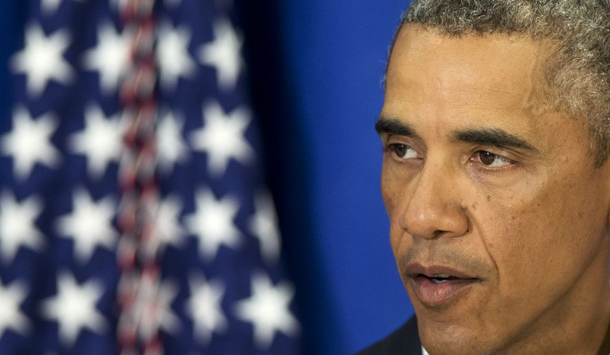 President Barack Obama speaks about the situations in Iraq and in Ferguson, Mo., Thursday, Aug. 14, 2014, in Edgartown, Mass., his second statement to the media during the Obama family vacation on the island of Martha's Vineyard. (AP Photo/Jacquelyn Martin)