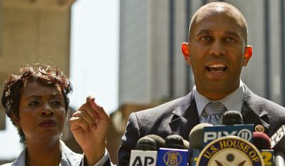 Congresswoman Yvette Clarke, left, listens as Congressman Hakeem Jeffries speaks during a press conference outside police headquarters on Thursday, Aug. 14, 2014, in New York. (AP Photo/Bebeto Matthews) ** FILE **