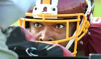 The Washington Redskins' Doug Worthington concentrates during a sled drill at the Redskins' morning practice at the Bon Secours Washington Redskins Training Center Monday, Aug. 11, 2014, in Richmond, Va. (AP Photo/Richmond Times-Dispatch, P. Kevin Morley )