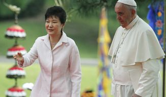 South Korean President Park Geun-hye, left, leads Pope Francis after a welcome ceremony at the presidential Blue House in Seoul, South Korea, Thursday, Aug. 14, 2014. Pope Francis became the first pontiff in 25 years to visit South Korea on Thursday, bringing a message of peace and reconciliation to the war-divided peninsula.  (AP Photo/Kim Hong-ji, Pool)