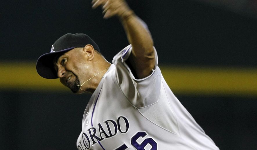 Colorado Rockies starting pitcher Franklin Morales throws in the first inning during a baseball game against the Arizona Diamondbacks, Sunday, Aug. 10, 2014, in Phoenix. (AP Photo/Rick Scuteri)