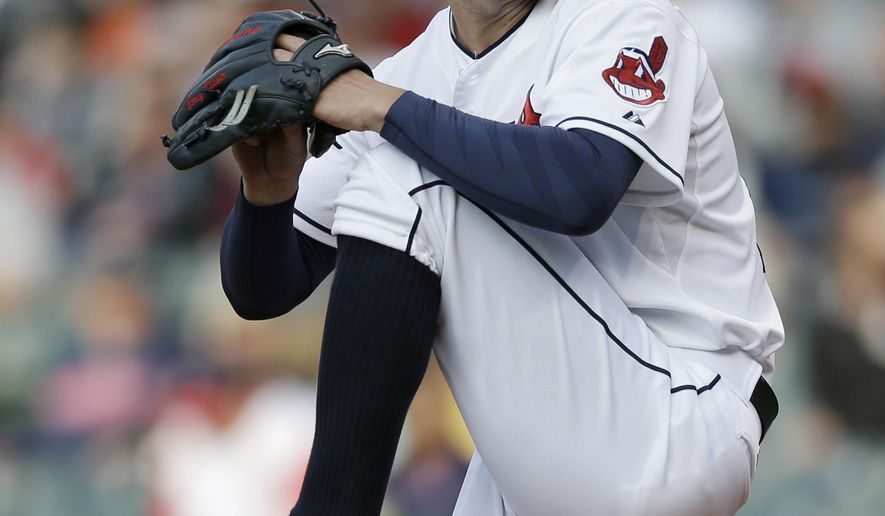 Cleveland Indians starting pitcher Corey Kluber delivers in the first inning of a baseball game against the Baltimore Orioles, Friday, Aug. 15, 2014, in Cleveland. (AP Photo/Tony Dejak)