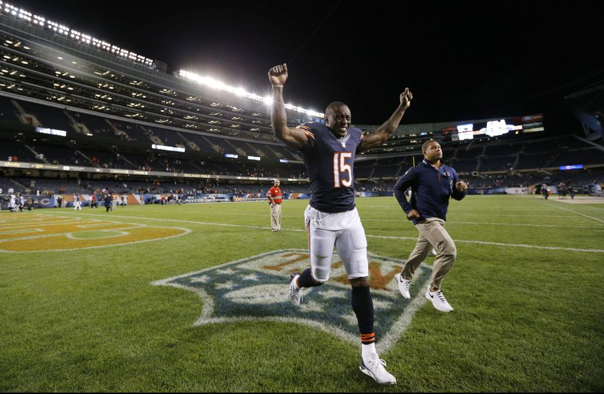Chicago Bears wide receiver Brandon Marshall runs off the field after the Bears' 20-19 win over the Jacksonville Jaguars in an NFL preseason football game in Chicago, Thursday, Aug. 14, 2014. (AP Photo/Charles Rex Arbogast)