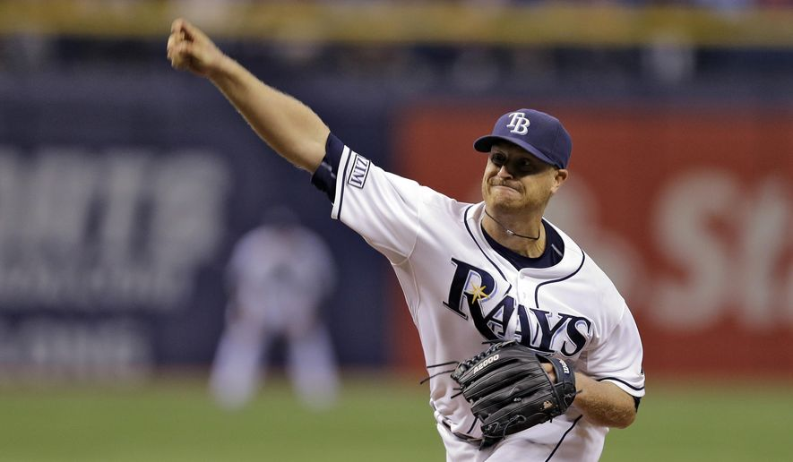 Tampa Bay Rays starting pitcher Alex Cobb delivers to the New York Yankees during the seventh inning of a baseball game Friday, Aug. 15, 2014, in St. Petersburg, Fla. (AP Photo/Chris O'Meara)